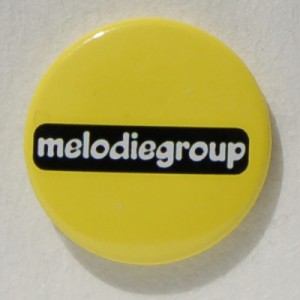 yellow logo badge